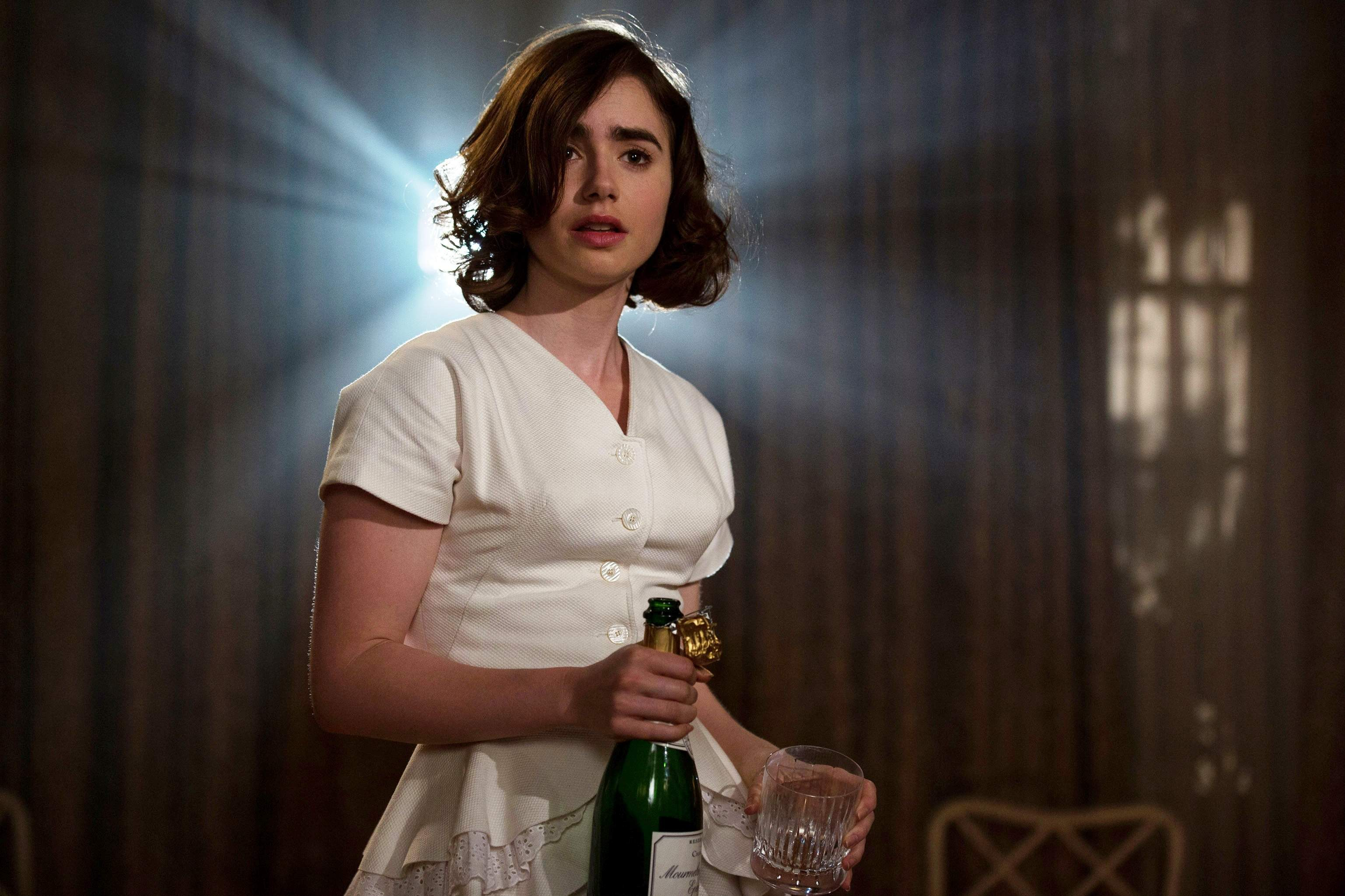 "This image shows Lily Collins in a scene from ""Rules Don't Apply."" (Regency Enterprises)"