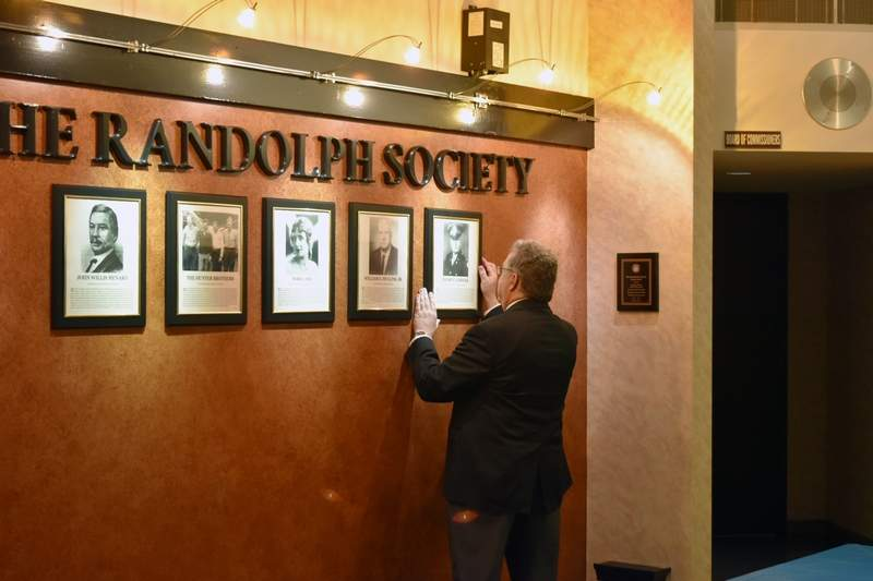 Randolph Society Chairman Marc Kiehna places the plaque of Henry F. Gerecke on the wall of the Randolph County Courthouse on Feb. 28. The inaugural 2017 class of Randolph Society honorees had their plaques placed during a special reception with several family members of the honorees in attendance.