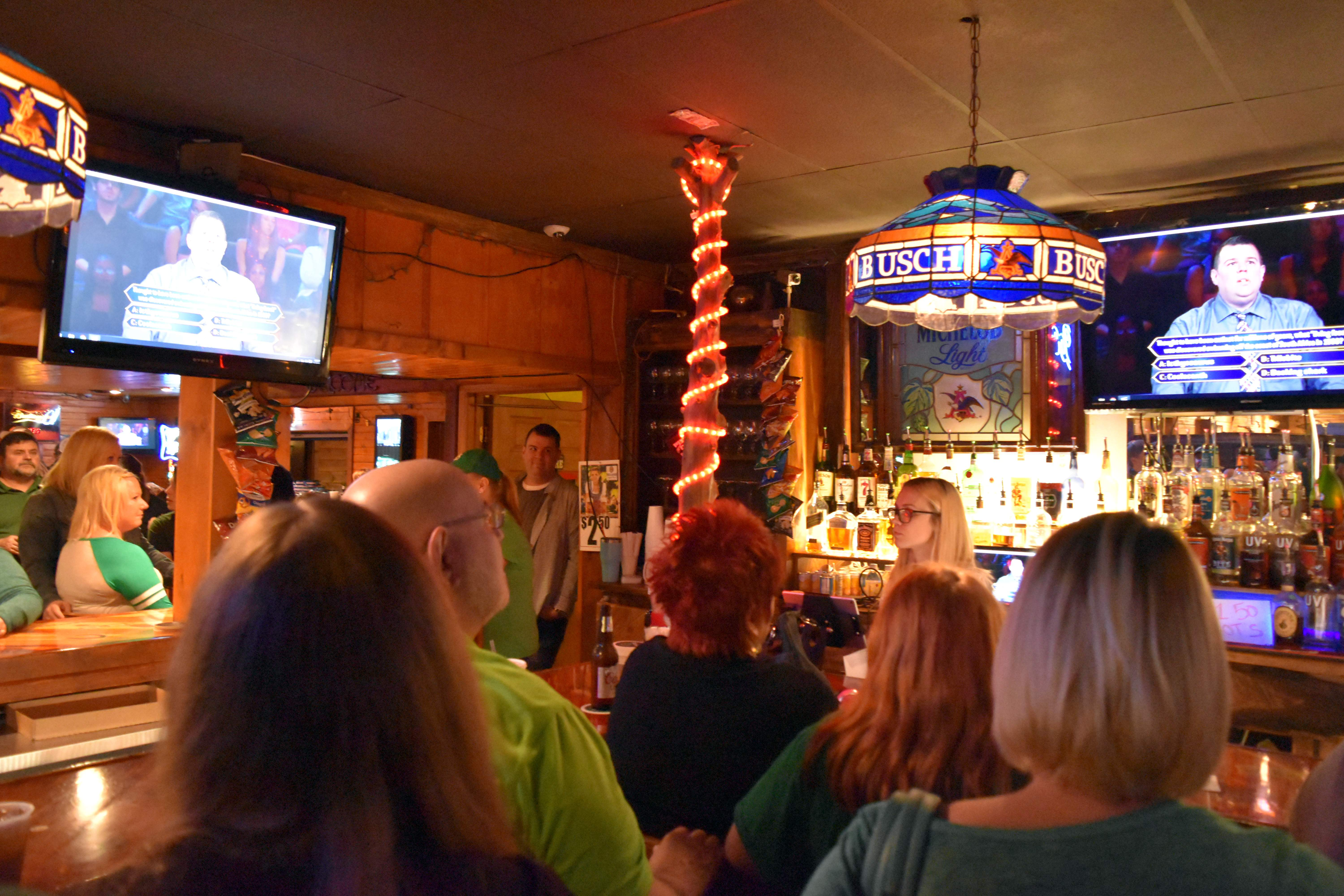 """Patrons at Pistol City Restaurant and Saloon in Coulterville watch the establishment's general manager, Kyle Hinnerichs, compete on """"Who Wants to Be a Millionaire?"""" last Friday. Pistol City hosted a viewing party for Hinnerichs' appearance, which was taped in August 2016."""