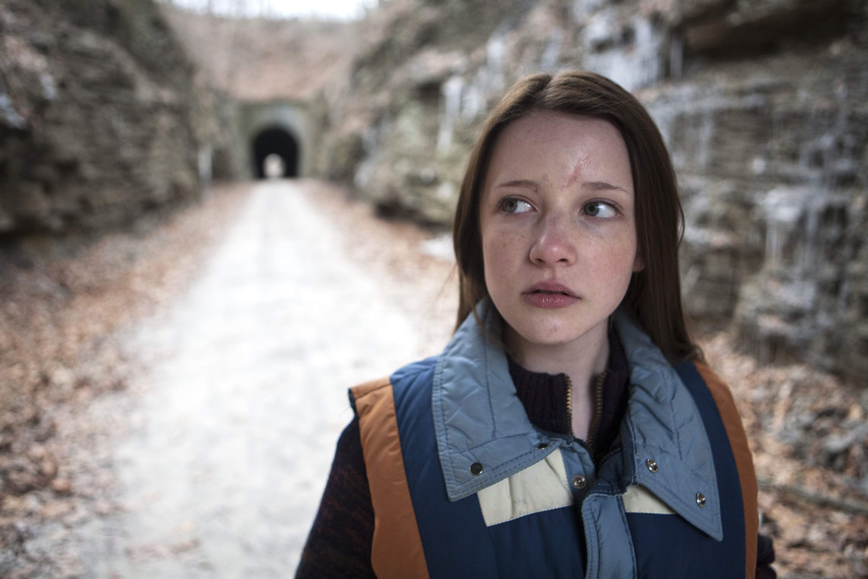 Actress Samantha Isler (playing Jake Mather) is shown in a scene shot on the Tunnel Hill State Trail in Johnson County.