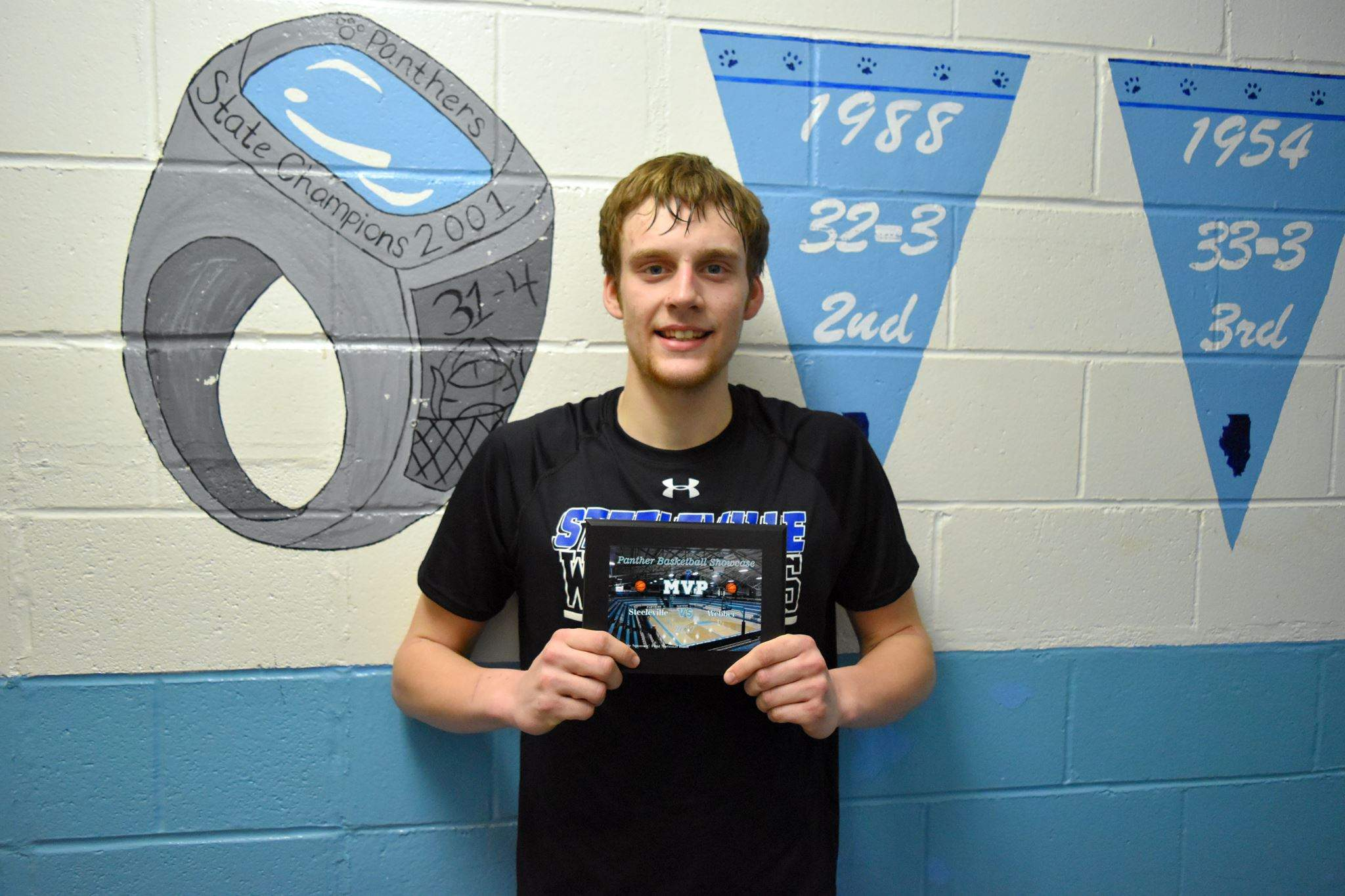 Steeleville High School senior Reid Frederking displays the MVP award he received from the Warriors' game against Webber Township in the Panther Basketball Classic in January. Frederking, who scored 30 points at the PBC, has been selected to the John A. Logan All-Star Classic on April 9.