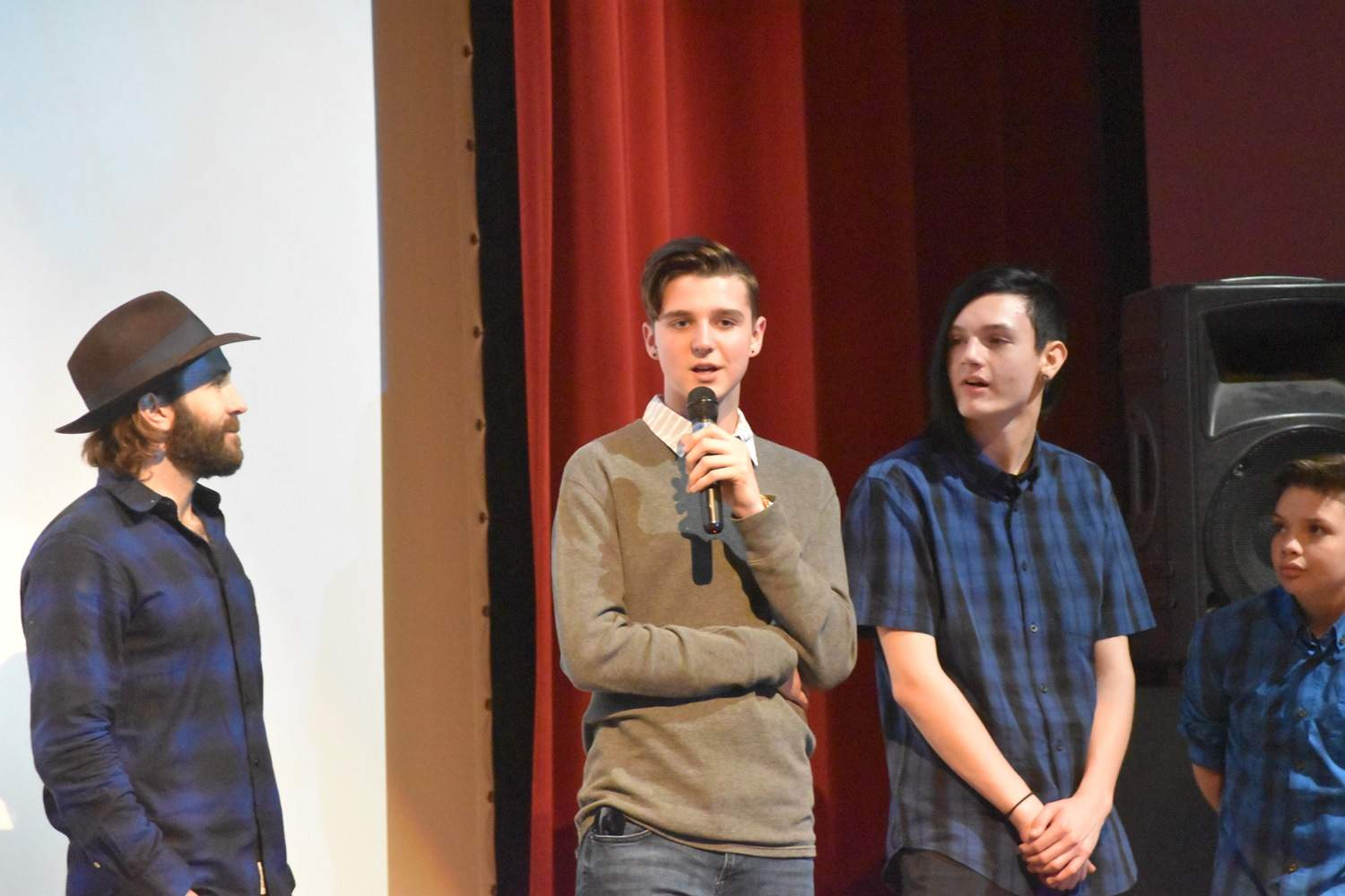 Gabe Cain, a Herrin High School freshman, speaks during the Q&A session. Cain had no previous acting or performing experience, but landed the role of Willie Proctor after auditions.