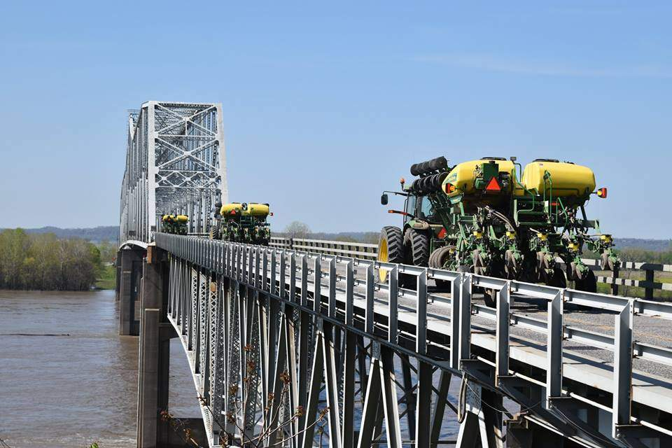 Farming machinery crosses the Chester Bridge on April 11. Engineering consultant CH2M is developing a website that will allow members of the public to track the progress of the environmental study that is part of the process toward eventual replacement of the 75-year-old bridge.