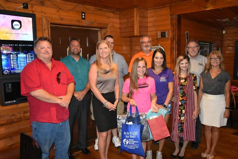Pictured are, from left, Curt Jeffers (Border North Marketing), Andy Gerlach (Randolph Mutual Insurance), Alinda Jeffers (Country Financial), Kyle Hinnerichs (Pistol City Restaurant and Saloon), Summer Hasselbrock, Terry Nagel (Williams Heating and Air), Katie Sidener (TK's Essential Fitness), Beth Jackson (Lularoe), Bruce Guebert (First National Bank of Steeleville) and Angela Truluck (First National Bank of Steeleville) during a presentation of gifts at Pistol City Restaurant and Saloon in Coulterville on Thursday. The 12-year-old Hasselbrock was the victim of a theft during the Steeleville 4th of July parade and received a variety of products and services from area businesses as a result of the incident.
