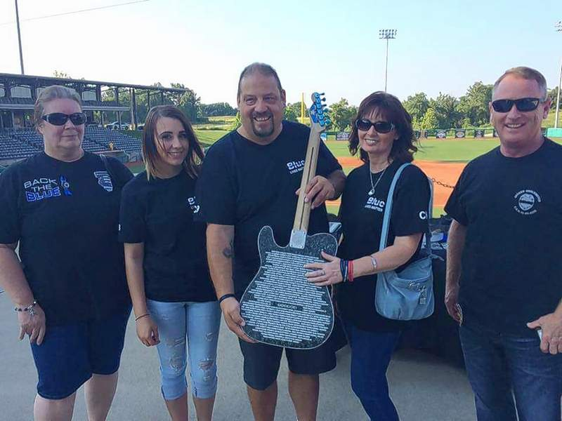 Pictured are, from left, Kathy Bowen, Megan Brockmeyer, Don Brockmeyer, Dixie Brockmeyer and Chester Police Department Sgt. Bobby Helmers on Thursday at Rent One Park in Marion.