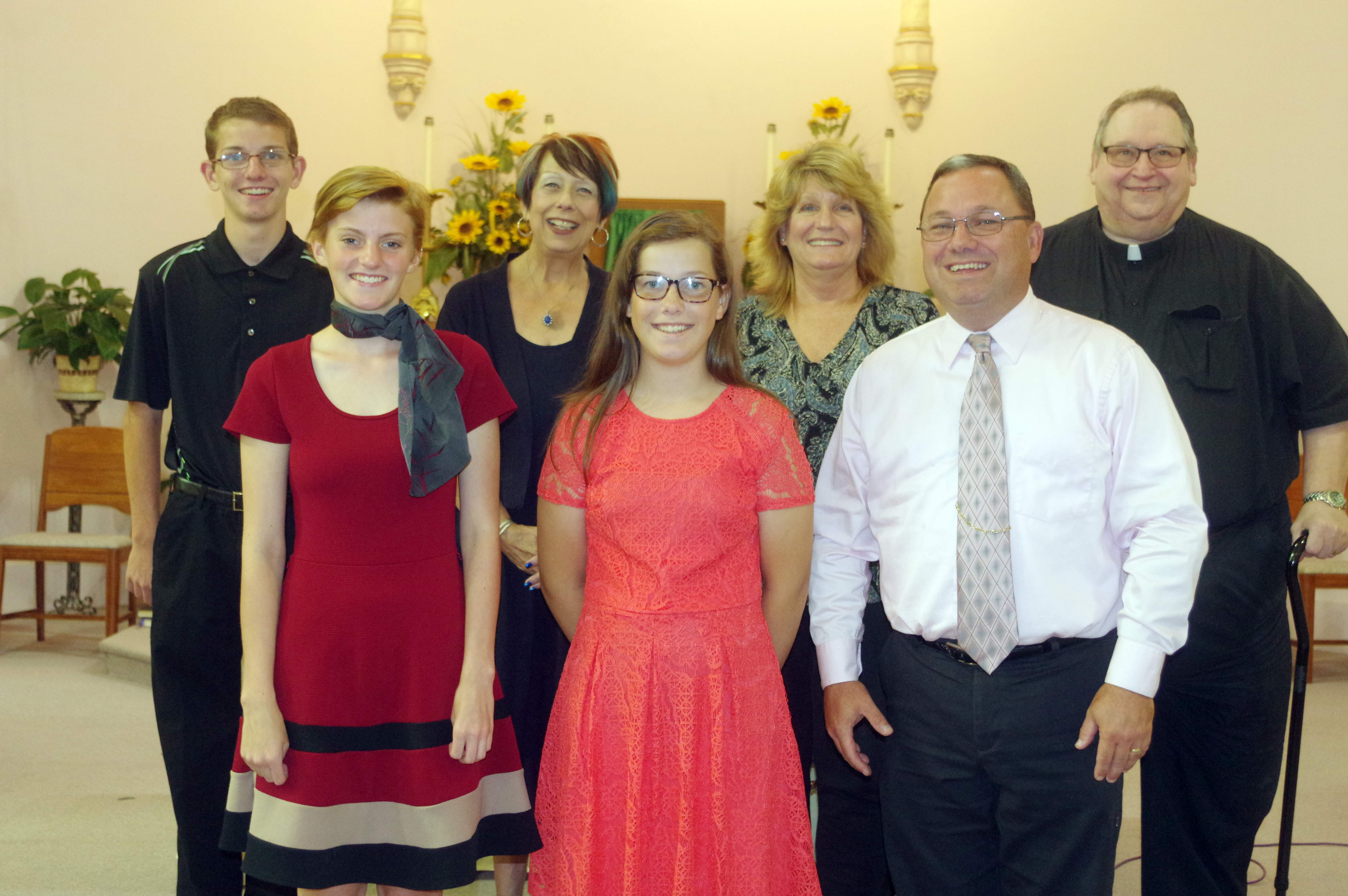 The Sacred Concert, associated with the 38th annual Popeye Picnic, took place Sunday at St. Mary's Catholic Church in Chester. Pictured are, front row from left, Kylie Liefer, soloist; Melody Colonel, soloist; and Steve Colonel. Back row, from left, Mitchell Colonel, soloist; Gwendy Garner, concert coordinator; Vicky Beers, piano prelude and accompanist and Father Eugene Wojcik, master of ceremonies.