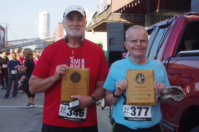 Two long-standing Popeye Race participants were presented special awards prior to the start of the 38th Annual Popeye 5K Race, 5K Competitive Walk and and 1.5-Mile Fun Run/Walk. Thomas Feeley, of Belleville (left), is the only remaining participant that has competed in every one of the 38 Popeye races over the years. Dick Keegan of Mount Vernon, has participated in 27 of the 28 Competitive Walks.