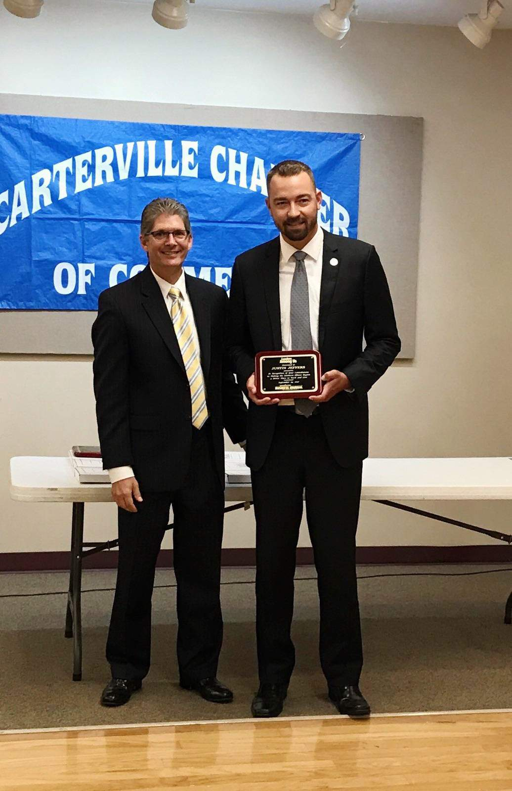 "Randolph County Treasurer Justin Jeffers (right) is pictured with The Southern Illinoisan publisher Craig Rogers during a ""Leaders Among Us"" ceremony at the Carterville Community Center."