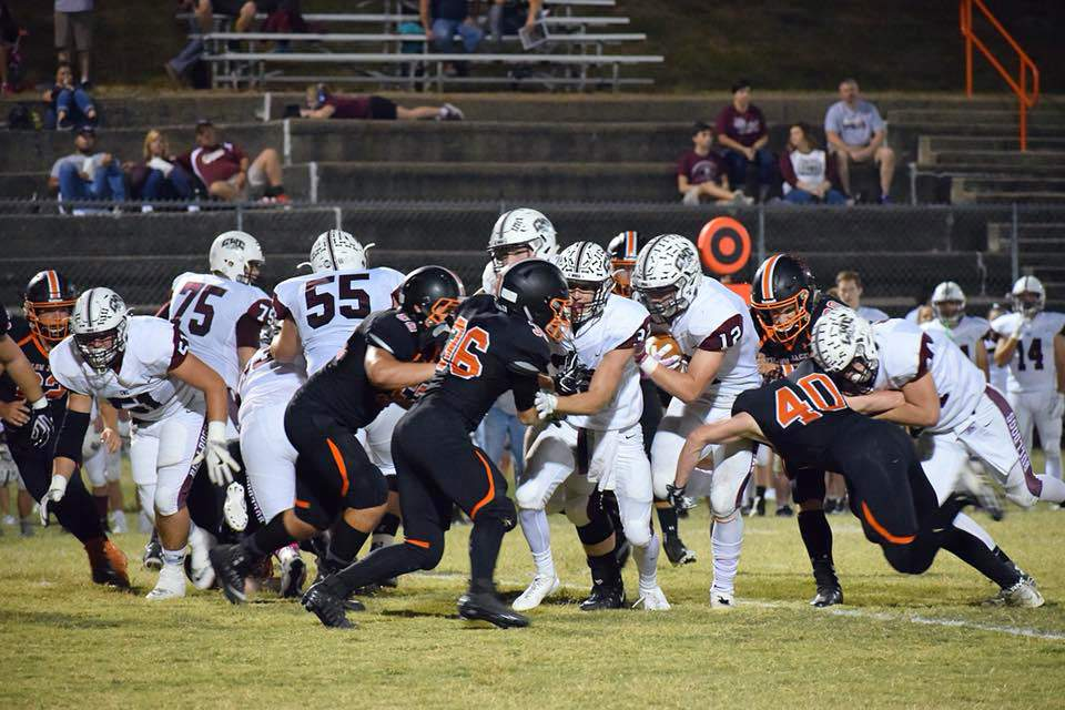 Chester players swarm around Carmi-White County's Colton Yates, who ran for 173 yards and two touchdowns in the Bulldogs' 34-7 win on Friday at W.O. Smith Field.