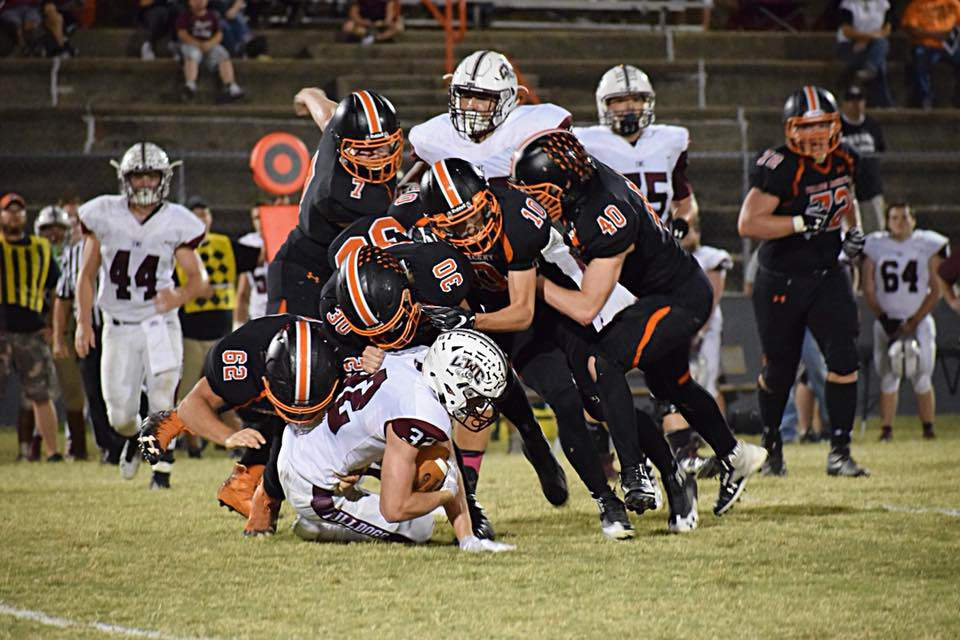 A swarm of Yellow Jackets tackle Carmi's Bryce Northcott.