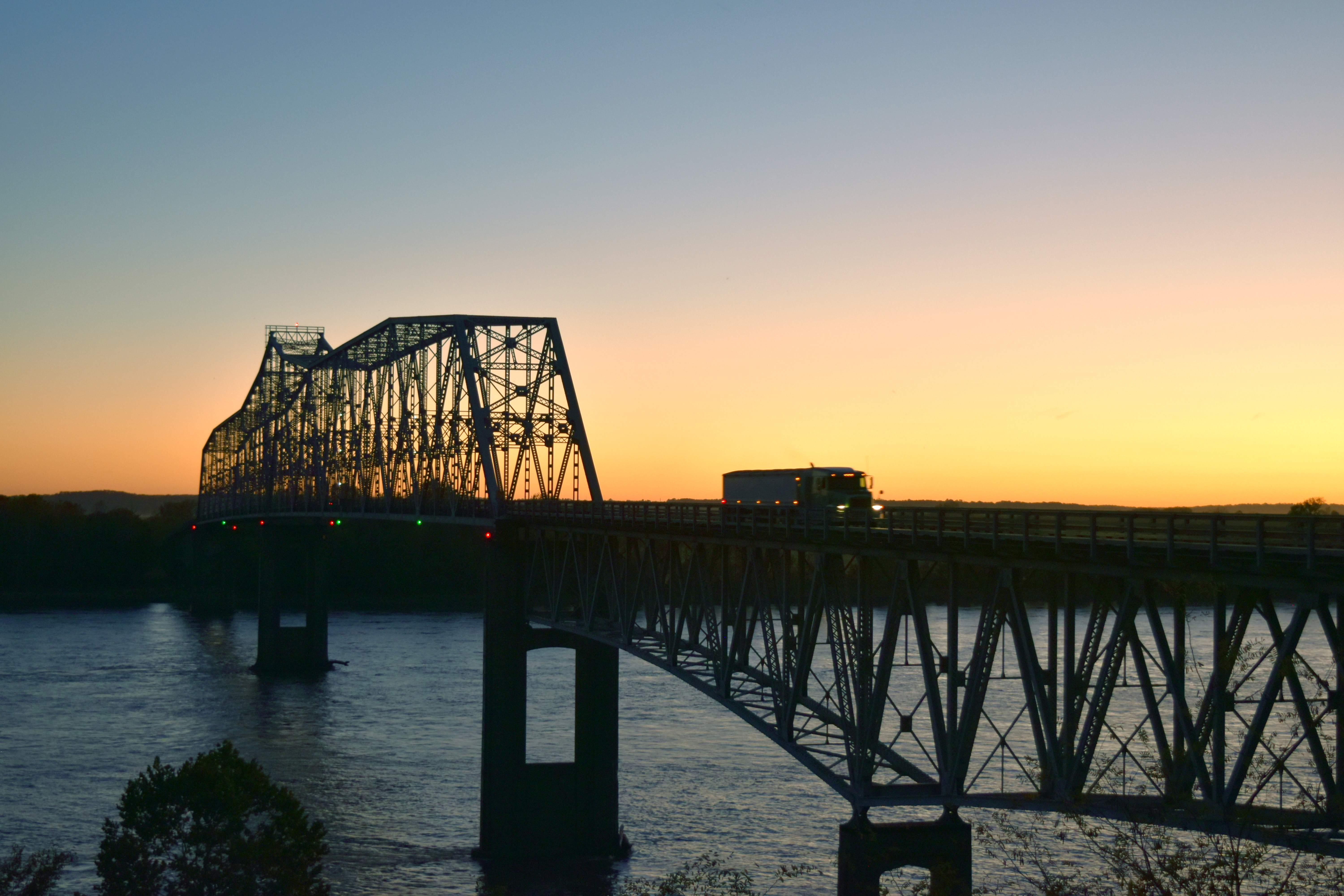 A grain truck crosses the Chester Bridge at sunset on Tuesday. The Community Advisory Group met for its second meeting on Oct. 12 at Perryville City Hall and learned more about accident data and inspection reports on the 75-year-old, World War II-era bridge.