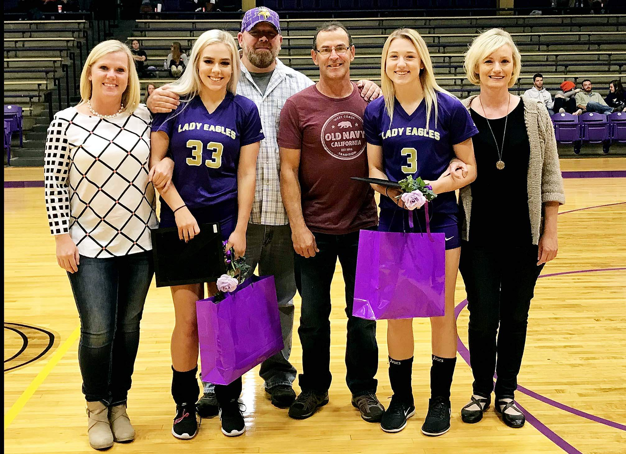 Eldorado seniors Madison Newton (left) and Olivia Parker (right) were recognized with their families prior to the Eagles' Senior Night win over Sesser-Valier.