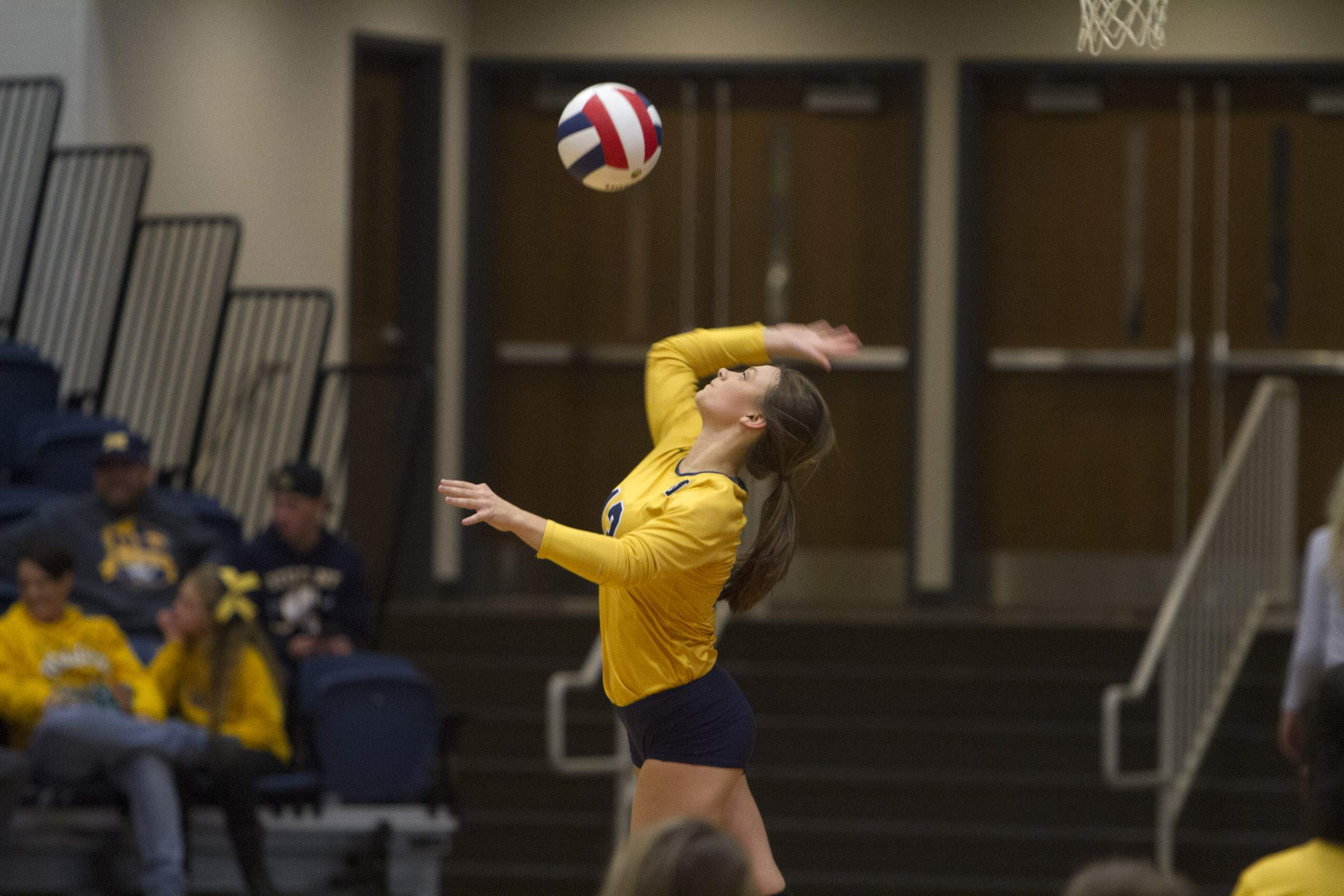 Kaylee Evans serves the ball.
