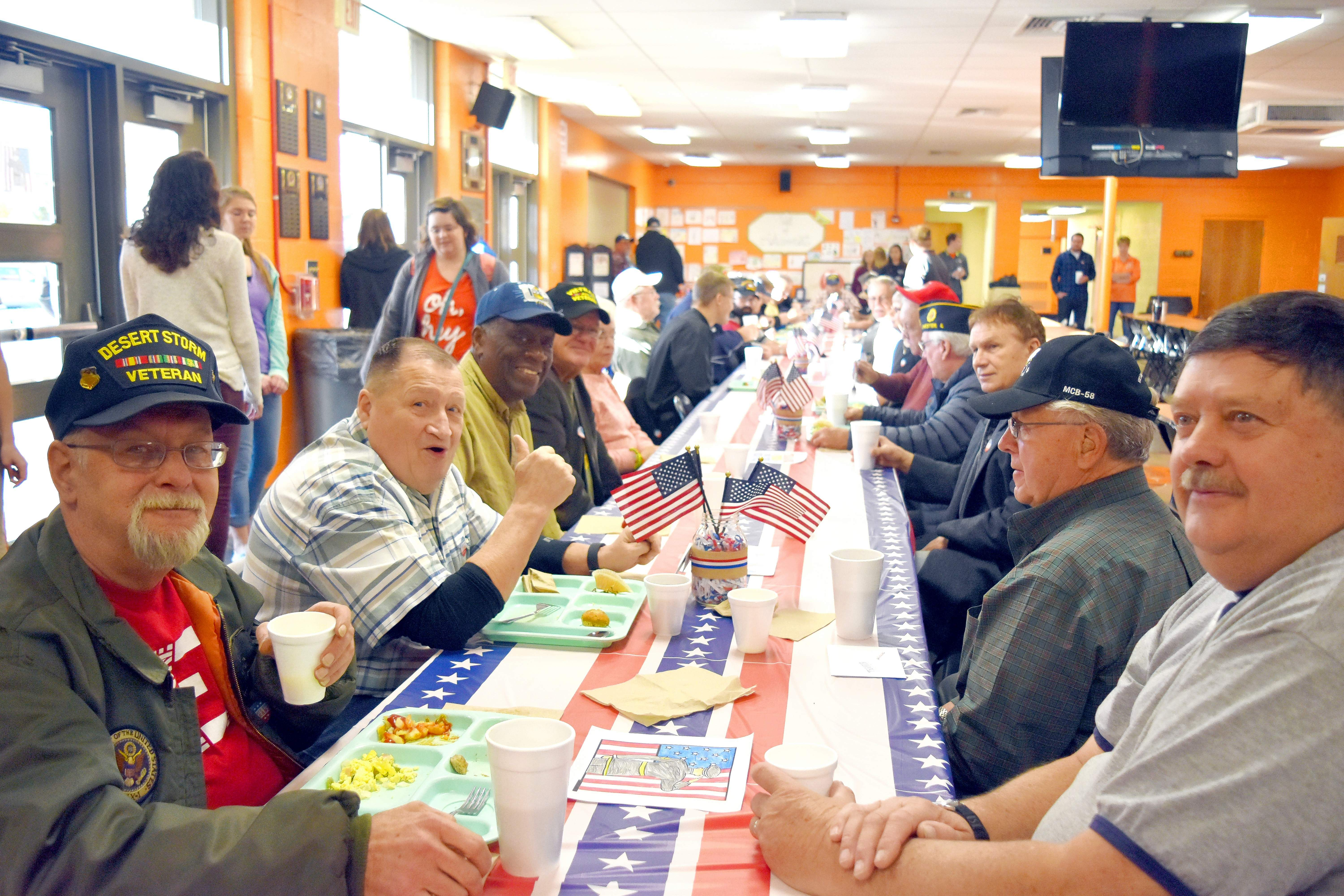 Pictured are, foreground from left, Ron Casetta (Marines), David Wright (Army), Walter McGee (Navy) and Dale Link (Army). Foreground from right, Bob Lockhart (Air Force) and Ron Rathert (Marines) during the Veterans Breakfast at Chester High School on Nov. 9.