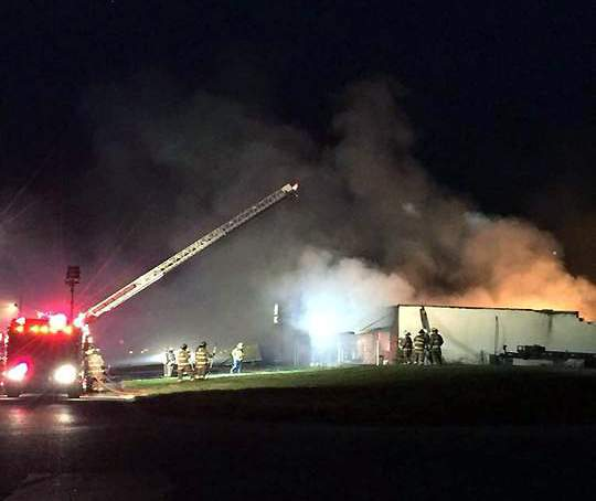A building operated by Jan Can Paint Service burns in Steeleville on Friday evening. Multiple fire departments were called to help extinguish the blaze.