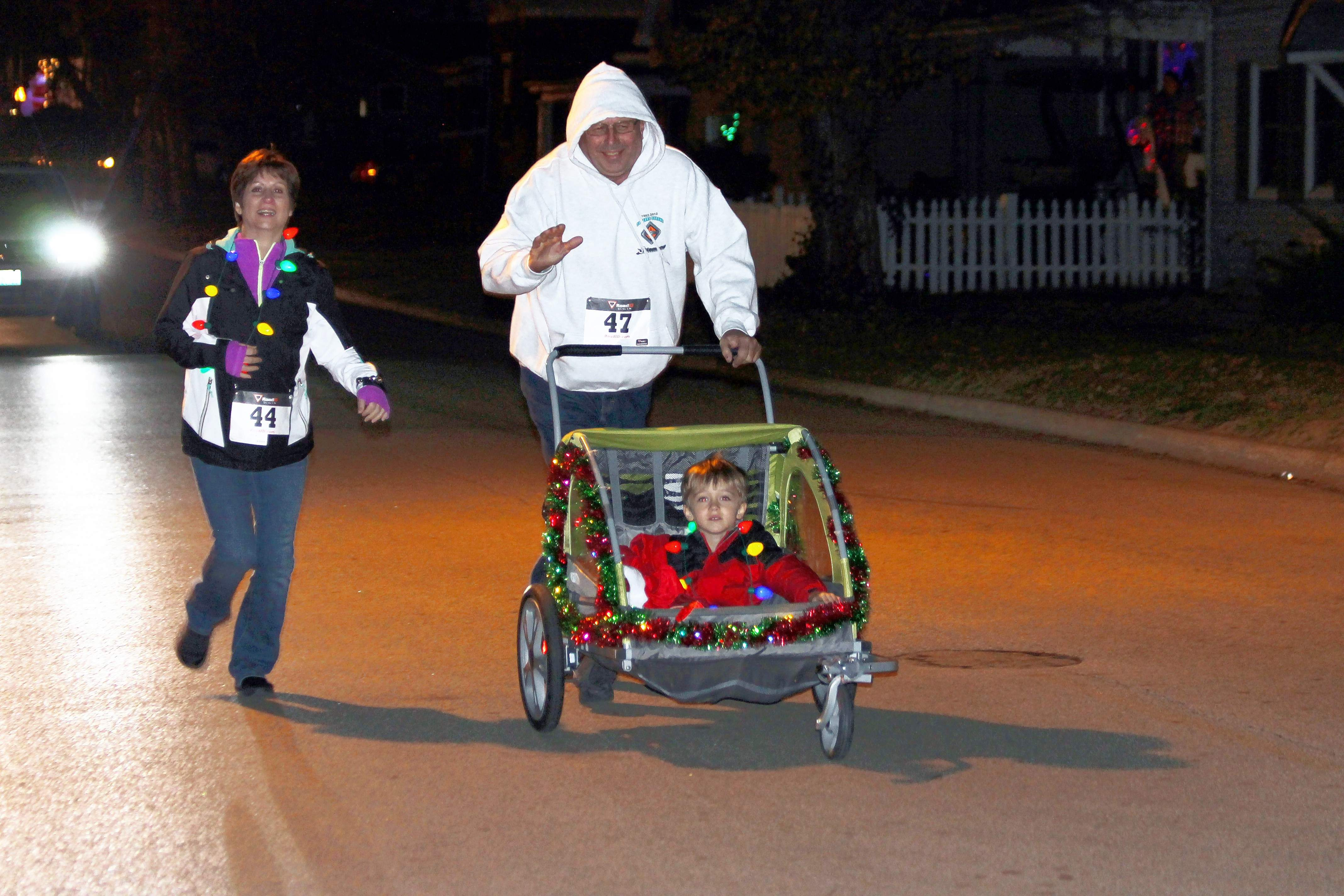 People participate in the Jingle Bell Fun Run that preceded the Lighted Parade.