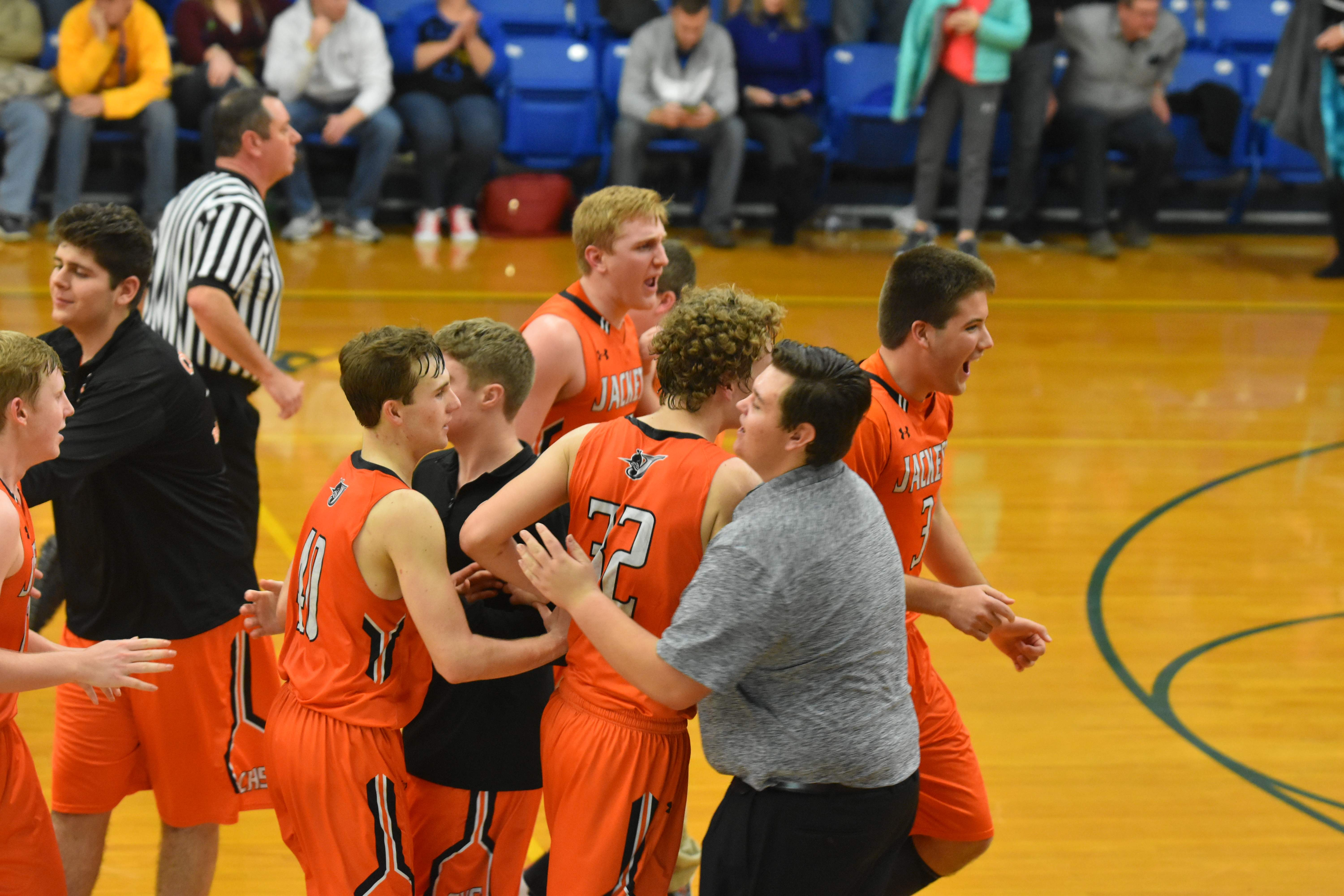 Chester's players celebrate after beating Trico, 73-70, in triple overtime on Friday. The Yellow Jackets improved to 7-2 overall and 2-1 in the BDC West with the win.
