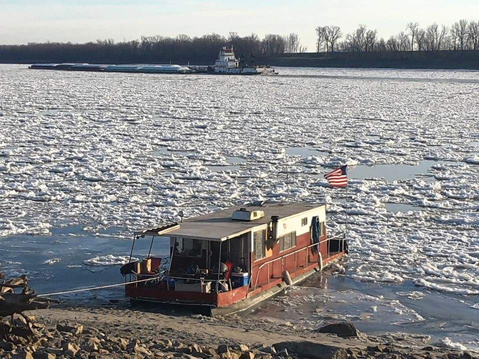A houseboat is tied to the Mississippi River bank in Chester on Jan. 4. The cold weather that enveloped southern Illinois the past two weeks has significantly frozen parts of the river in the region.