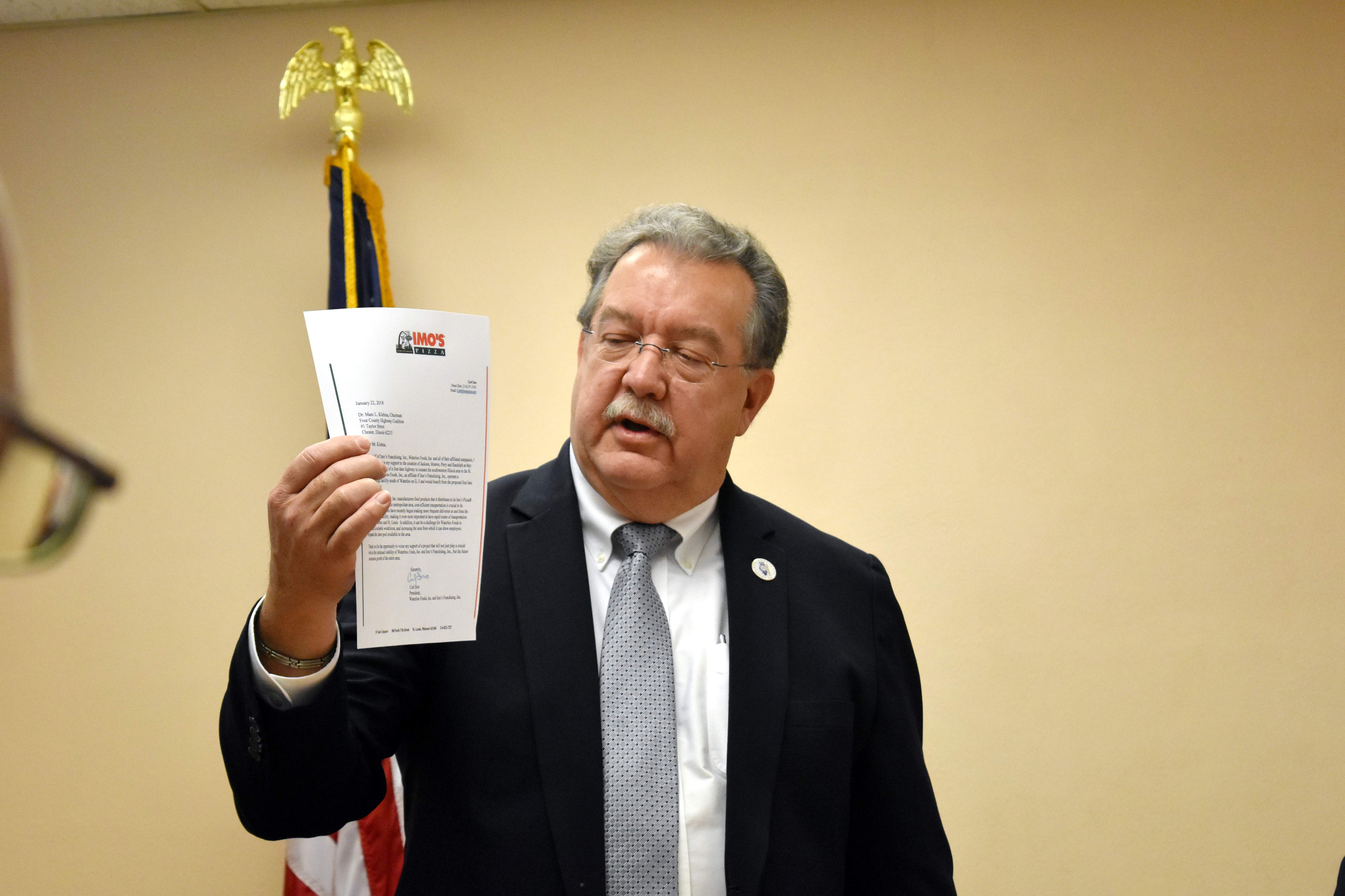 Four County Highway Coalition Chairman Marc Kiehna holds a letter of support he had received from Imo's Pizza. The letter was dated Jan. 22.