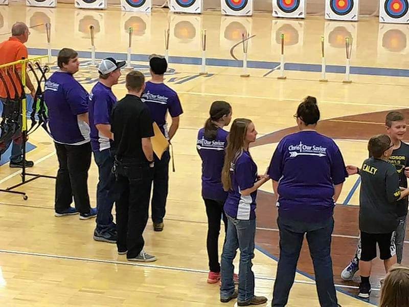 Some of Christ Our Savior Lutheran High School's Archers compete at the St. Louis Shootout hosted at Seckman H.S. in Imperial on Feb. 24. From left are Adam Sauerhage, Riley Smith, Assistant Coach Matt Foster, Victor Rahlfs, Annelise Quinn, Lexi Luebkemann and Rachel Rehmer.