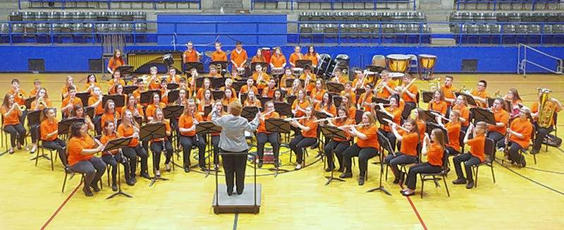 "Sue Colonel, CGS Band Director, directs the junior high band at the 2018 IGSMA contest. The band played ""Mad Dash"" by Timothy Loest; ""The Fortune Teller's Daughter"" by David Gorham"" and ""Abington Ridge"" by Ed Huckeby. They won three 1st Place Superior ratings."