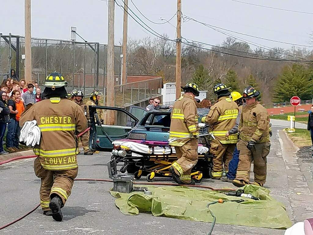 Chester firefighters converge on the scene of an accident as part of a demonstration staged for Chester High School students to show them the realities of irresponsible driving.