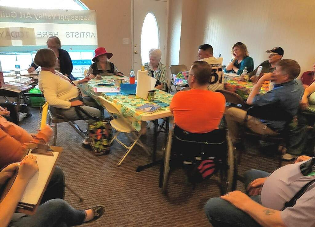 Mississippi Valley Art Guild President Frankie Eggemeyer Veach leads a recent meeting at the Guild's new location.