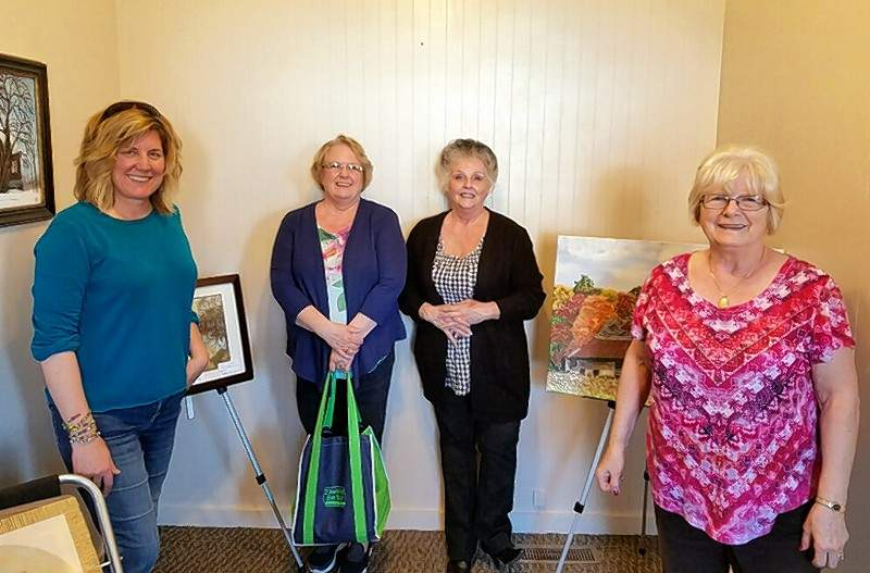 Melanie Barker, left, Tabitha Knope, Jeanne Phillips, and Barbara McCormick enjoy the new Mississippi Valley Art Guild facility.