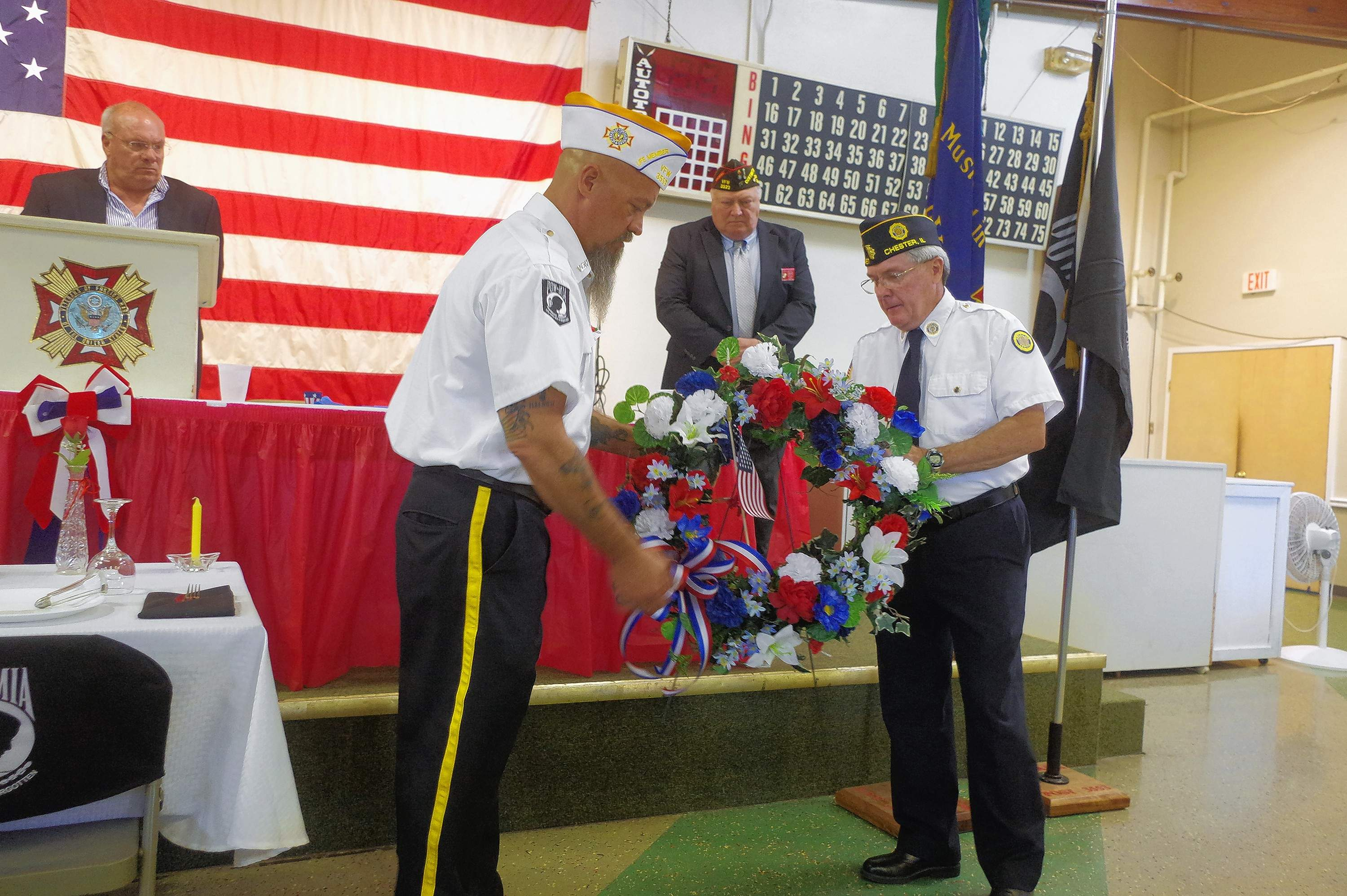 Chester VFW Post 3553 Commander Tony Payne (left) and Chester American Legion Post 487 Commander Jeff Warhausen (right) place a wreath in memory of the departed veterans at the 2018 Chester Memorial Day Service hosted at the Chester VFW Post.