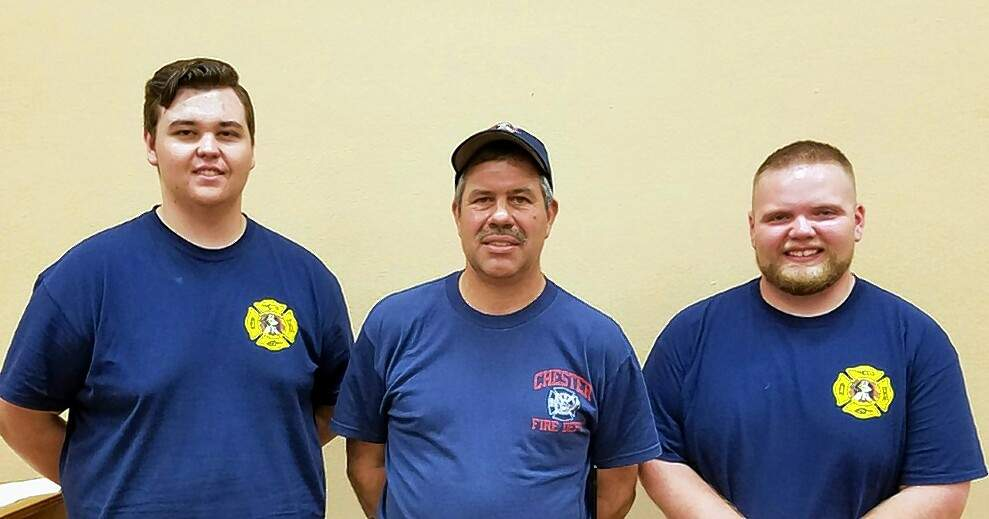 Chester Fire Chief Marty Bert, center, with new auxiliary firefighters Jared Meyer, left, and Lake Fogerson.