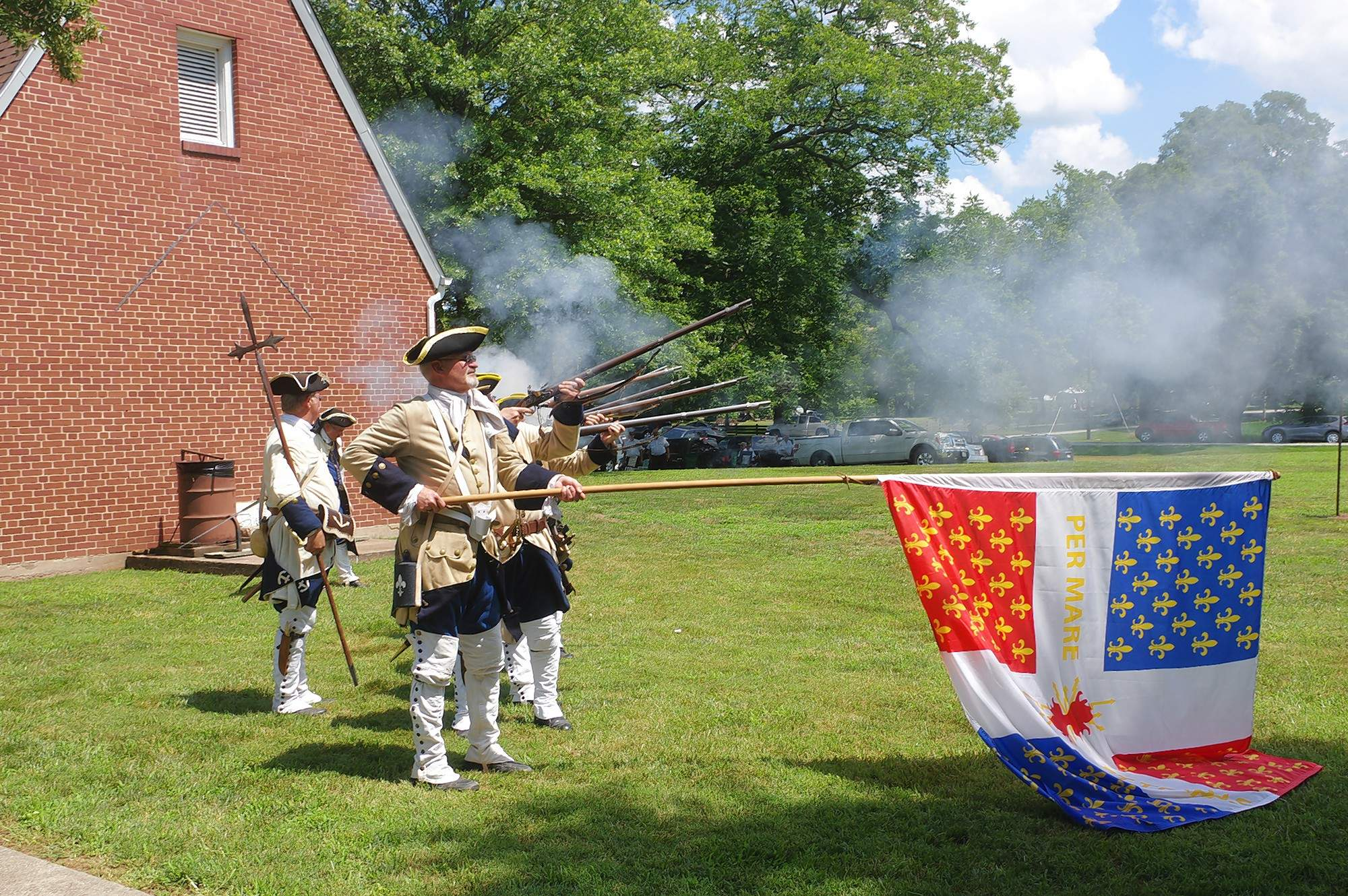 """The French Marines, de Forte de Chartres, led by Commander Don Martin, gave their traditional musket salute to hail the closing of the 2018 """"Let Freedom Ring"""" celebration on Kaskaskia Island July 4th.  Jim Beers Photo"""