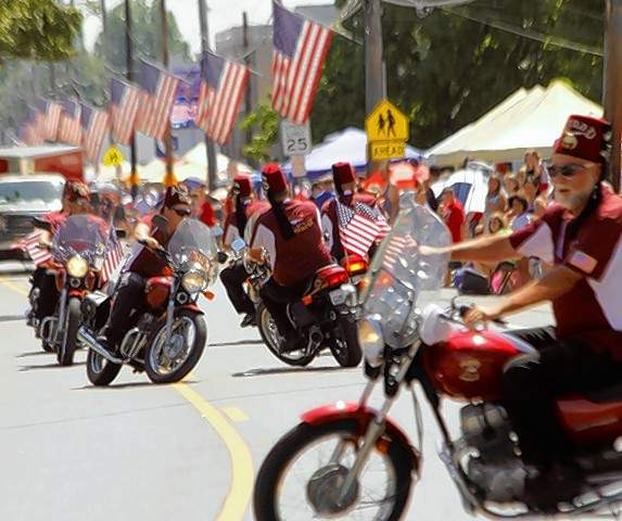The Ainad Temple Shriner perform manueveers on motorcycles at the Steeleville Fourth of July parade.