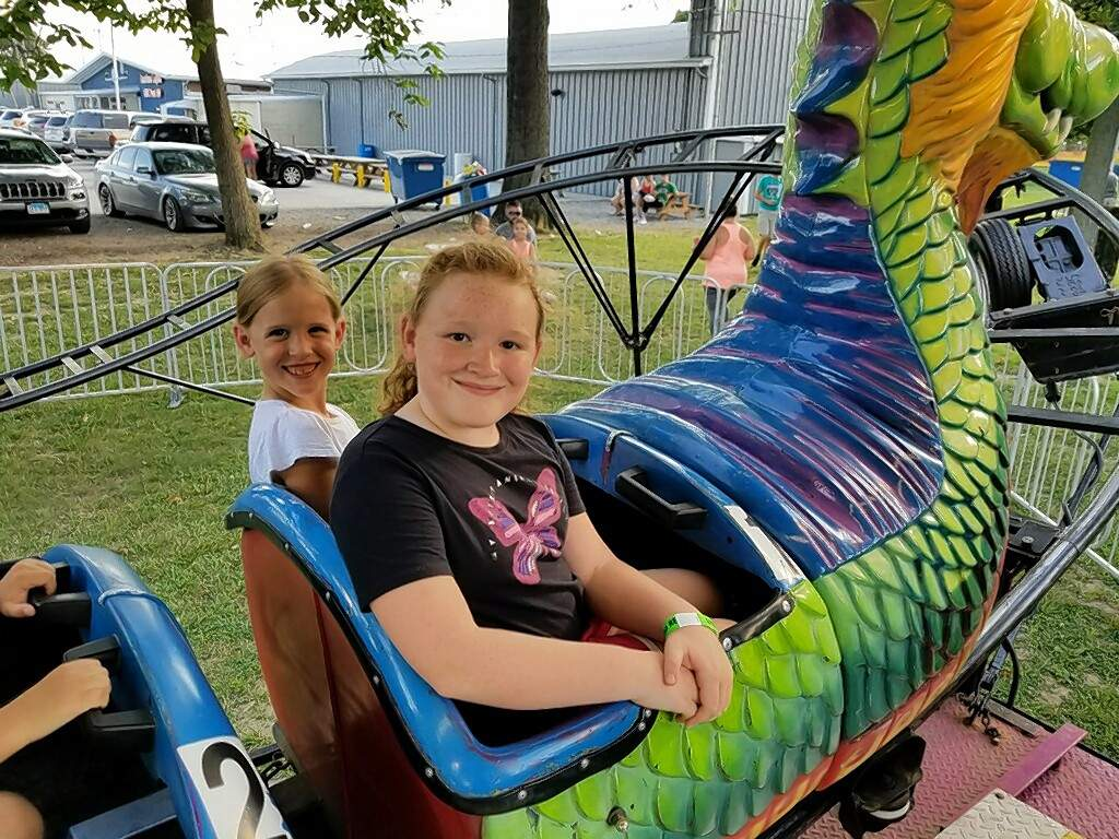 Left to right, 7-year-old Morgan Nanney and 9-year-old Kendall Nanney of Chester, prepare to ride the Dragon Wagon at the Fourth of July picnic in Steeleville.