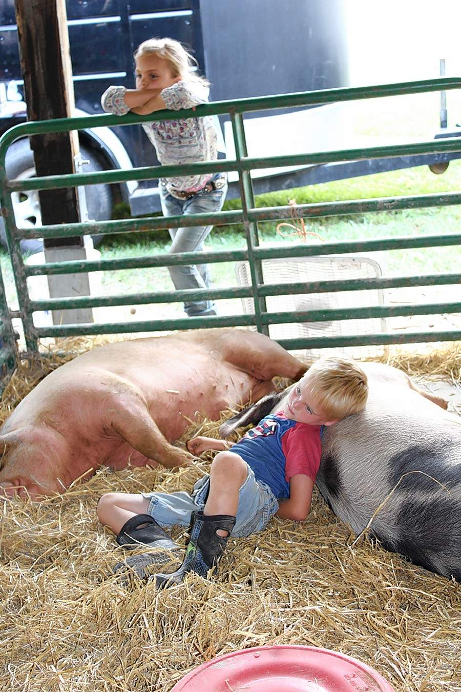 Loughlyn and Lawson Kurtz of Sparta rest after a long day at the 4-H fair Livestock Show in Perry County.