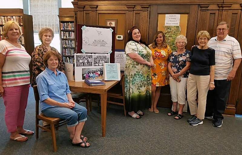 "People involved in the 1993 compilation of the ""Children Of The Flood"" manuscript at Chester Grade School include, from left, Kyle Koeneman, Emily Lyons, Eleanor Miller (seated), all teachers, now retired; Kelly Cowan and Becky Vieregge, both third grade illustrators in 1993; Melba Clendenin and Janet Baldwin, both teachers, now retired; and Larry Baldwin, Editor of ""Children Of The Flood."" Janet Baldwin also did manuscript illustration."