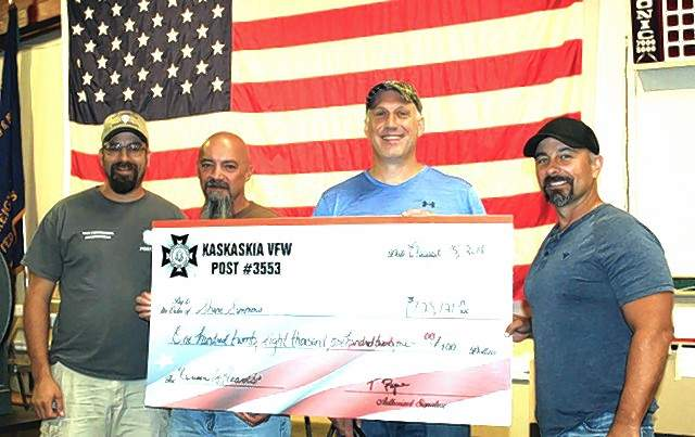 Queen of Hearts drawing winner Shane Simmons, right, is joined by Bud Stallman, left, junior vice commander of the Chester VFW; Commander Tony Payne; and Shannon McDonough.