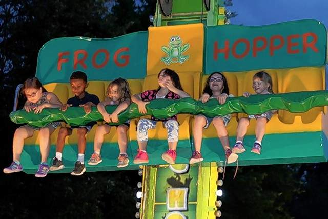 Children get a thrill on the Frog Hopper ride at the 39th Annual Popeye Picnic Sept. 7.
