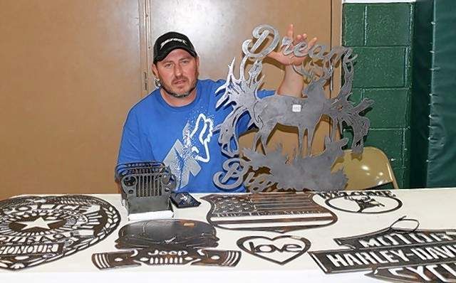 Rich Inman of Triple Fabrication shows his creations at the St. John Veterans Hall crafts fair.