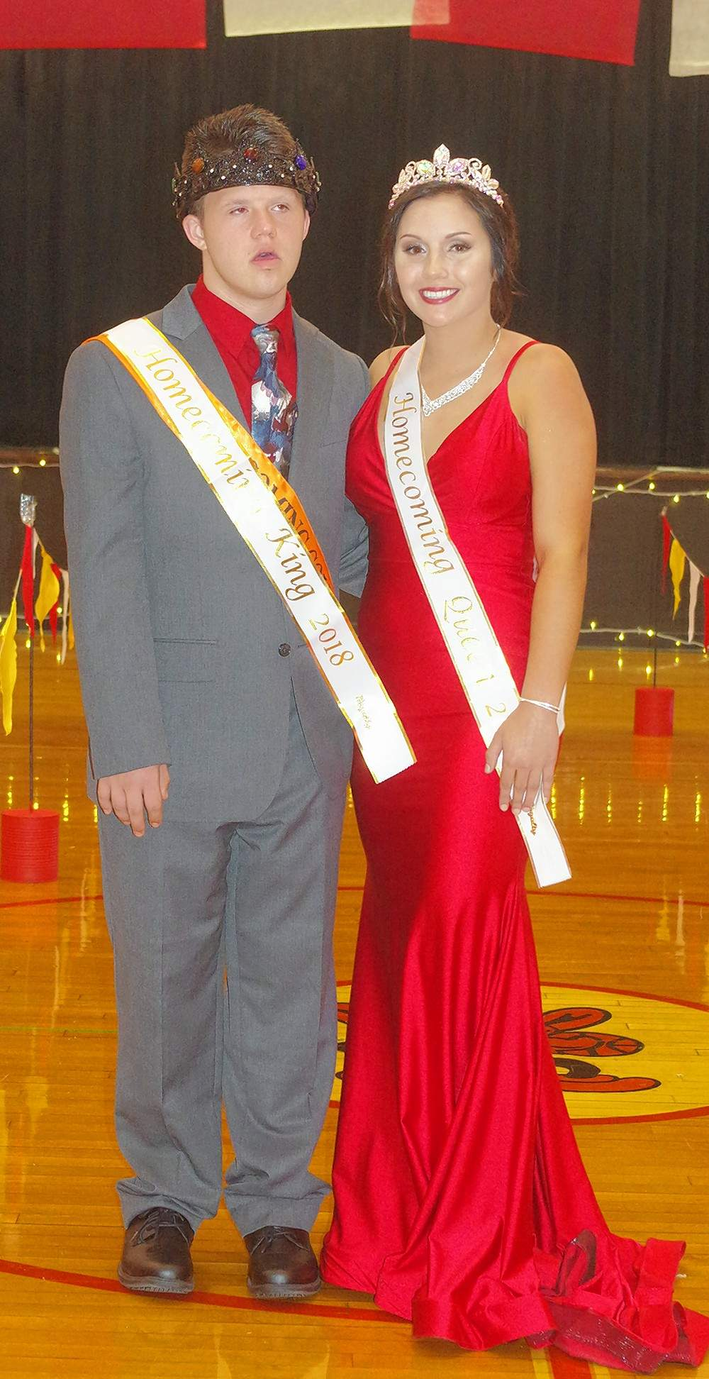 2018 Chester High School Homecoming King and Queen Austin Schweitzer and Shea Petrowske pose for a photo immediately following the coronation ceremony Sept. 29 at the 2018 Homecoming Dance.