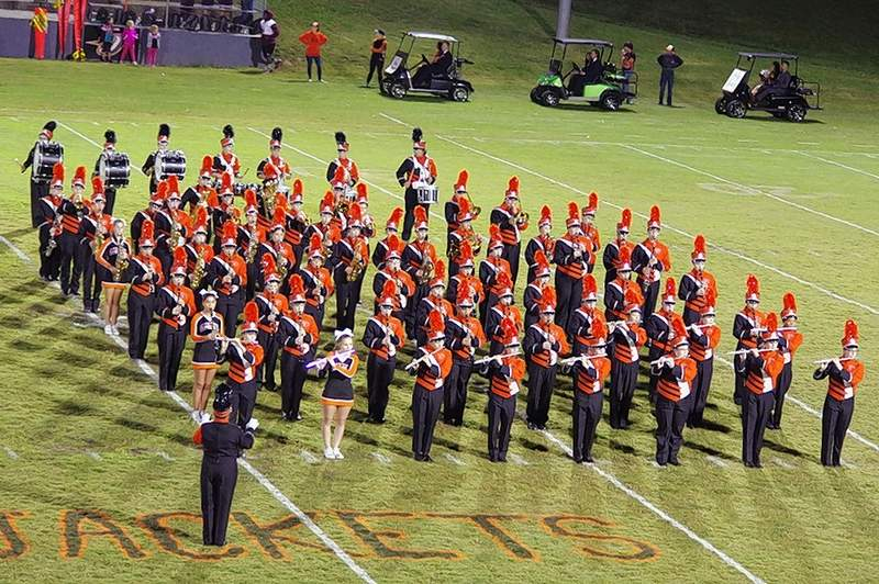 The Chester High School Marching Yellowjackets stand at attention at halftime of the CHS Homecoming game between the Yellowjackets and the Sesser-Valier-Waltonville Red Devils.