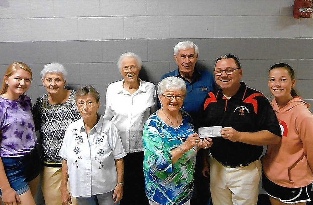 Ruth Schroeder Tiller, second from left, Gladys Zang Carter, Edna Dethrow Thompson, Betty Mennerich Wagner and Dale Grott are joined by Chester High School Music Director Steve Colonel, second from right, and CHS music students. The group represented the Chester High School Class of 1953, which donated $365 to the music department for its Florida trip to Disney World. The class has donated money to the department during its last several reunions.
