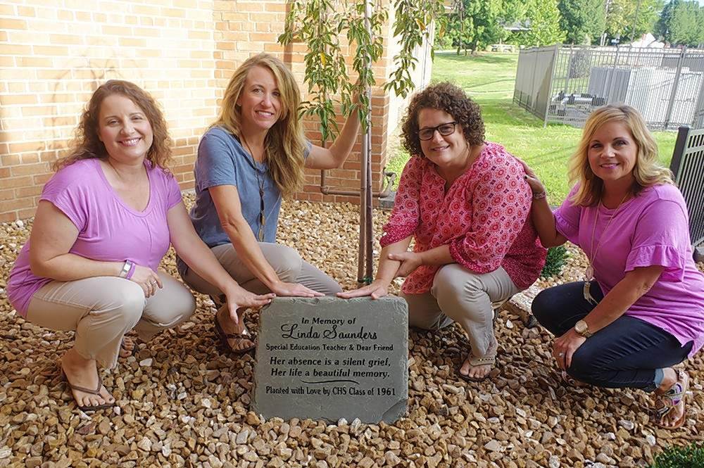 Chester Grade School special education teachers Rachel Francis, left, Nicole Wingerter, Lynne Gonzalez and Adrienne Klump with the Memorial Stone and tree for former teacher Linda Saunders.