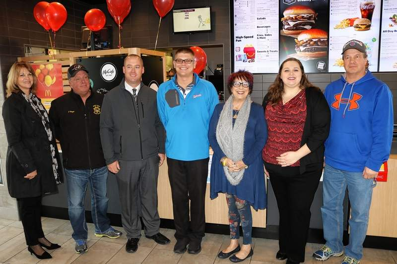 McDonald's owner Gary Hurst, Mayor Tom Page, Store Manager Ariel Crouch and members of the Chester Chamber of Commerce.