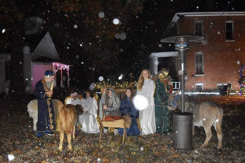 Local children portray biblical figures in a live Nativity scene Tuesday complete with live animals at the Saline Creek Historical Village and Museum in Harrisburg.