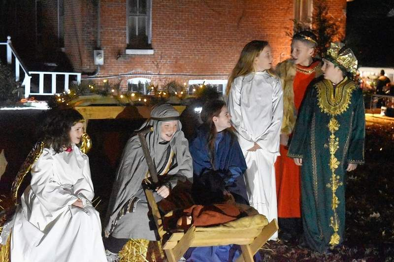 Local children portray biblical figures in a live Nativity scene Tuesday at the Saline Creek Historical Village and Museum in Harrisburg.