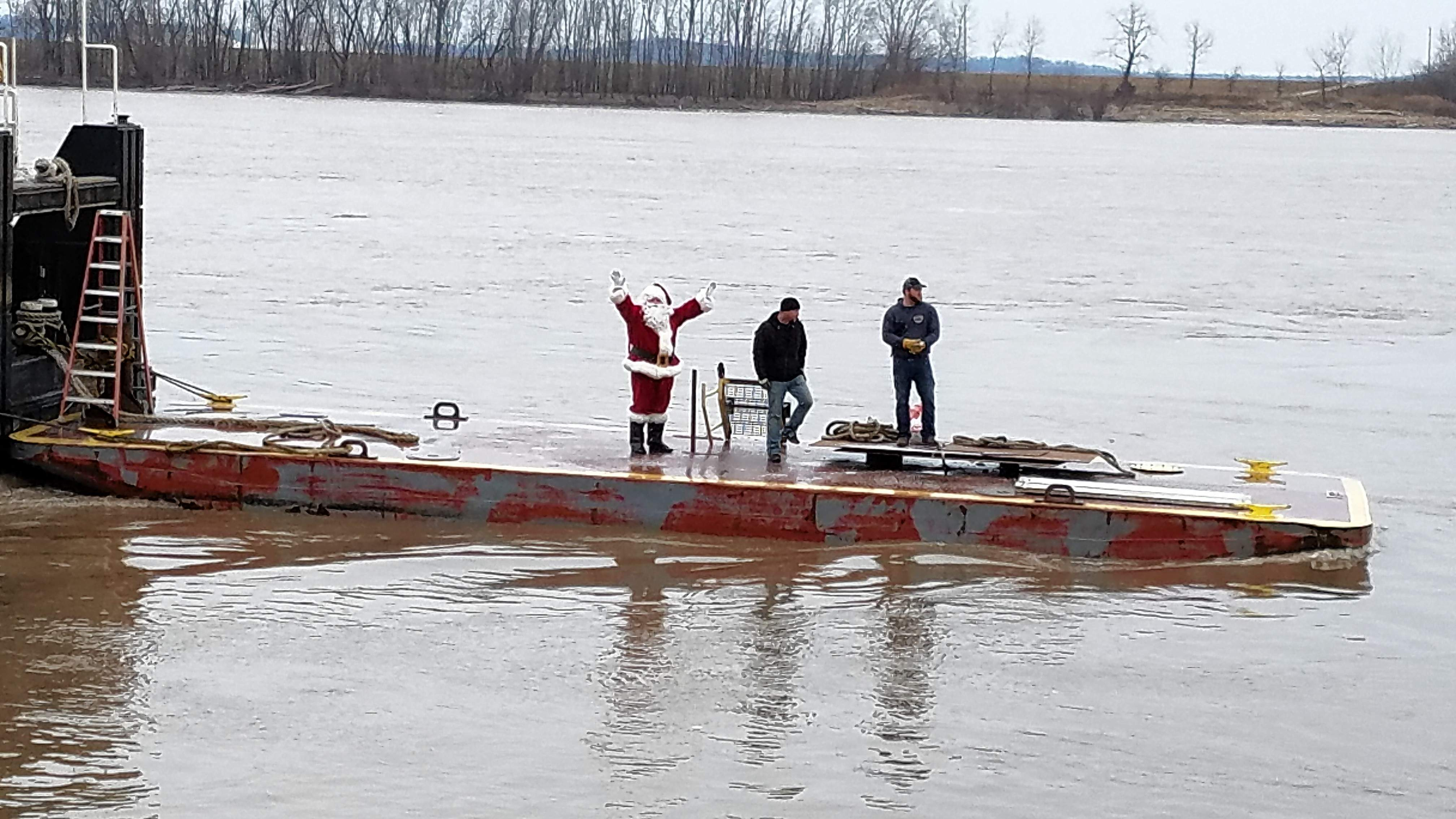 Santa makes a triumphant entrance to Chester aboard a barge, landing at the riverfront.