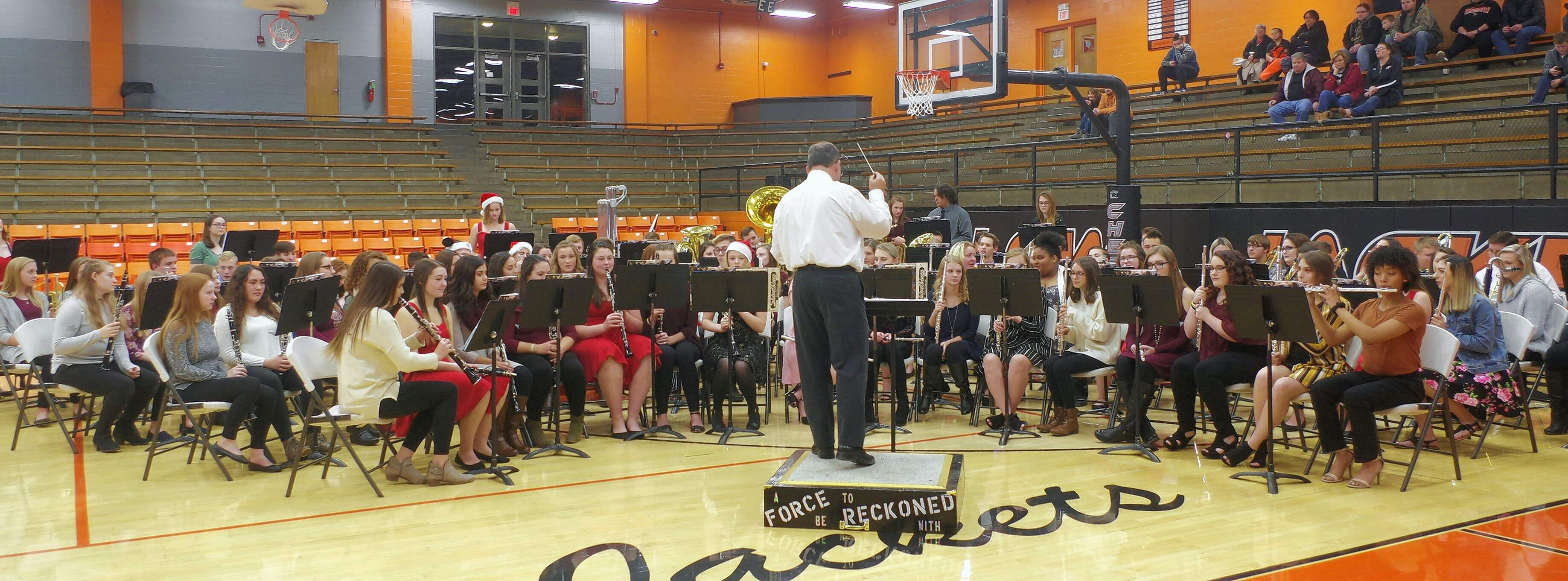 Steve Colonel, on podium, directs the Chester High School Concert Band.