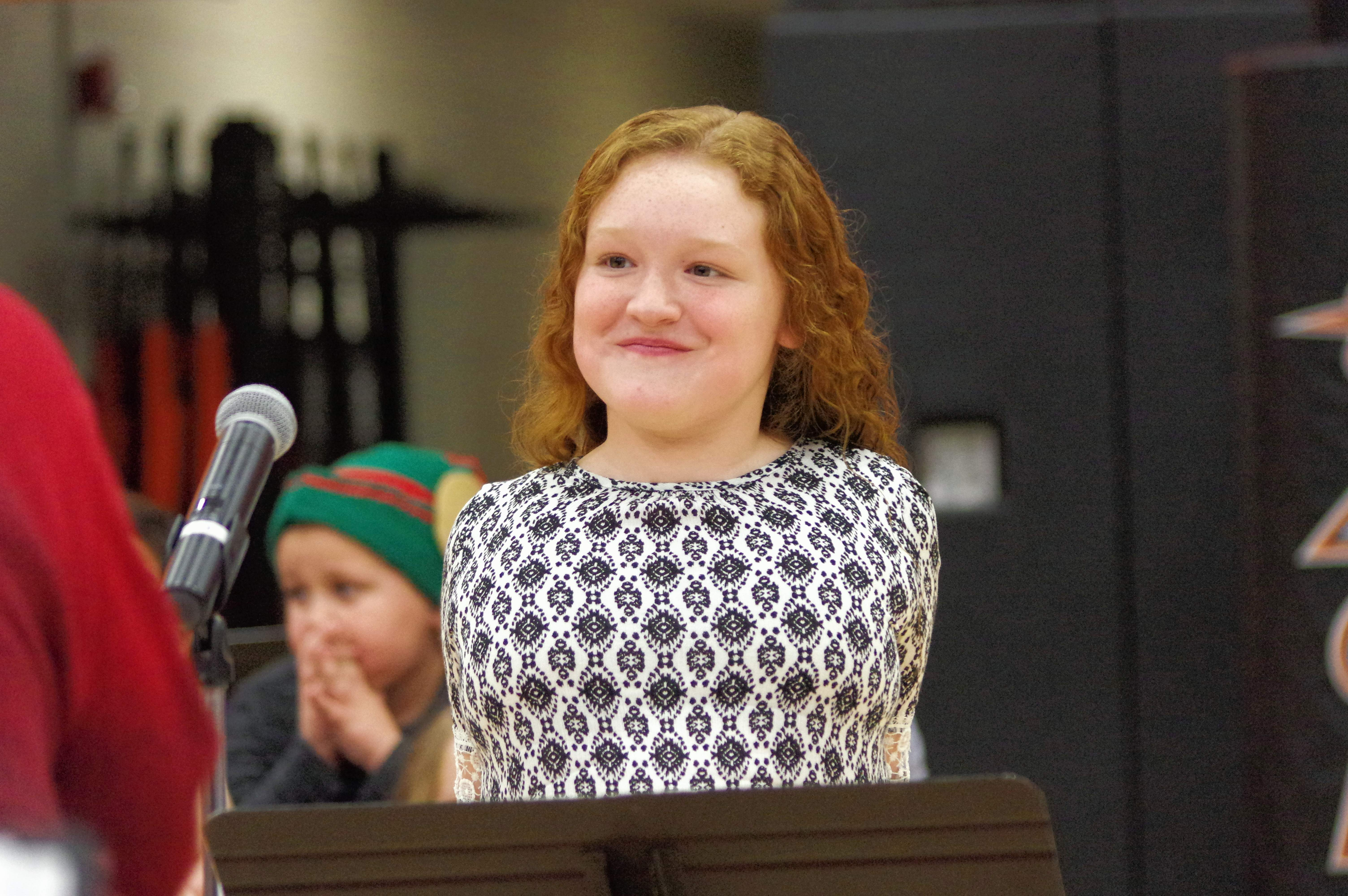 Fourth grader Kendall Nanney prepares to introduce the next song at the Christmas program. Kendall, daughter of Lucas and Ashley Nanney, served a emcee for part of the program.