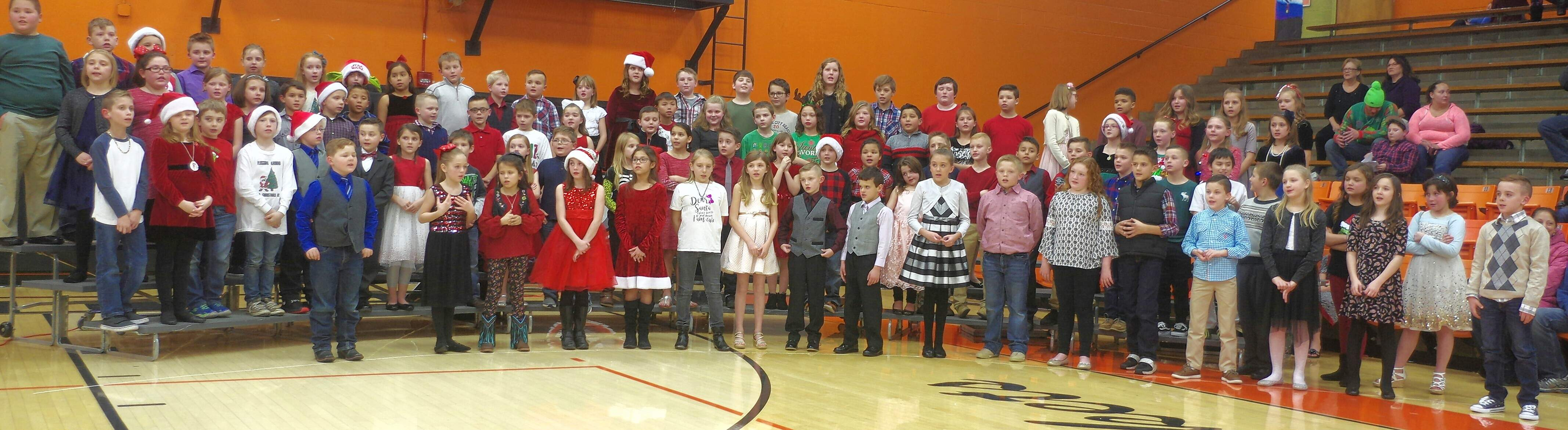 "The combined third-and fourth-grade chorus have a hit with ""Jingle Bell Rock."""