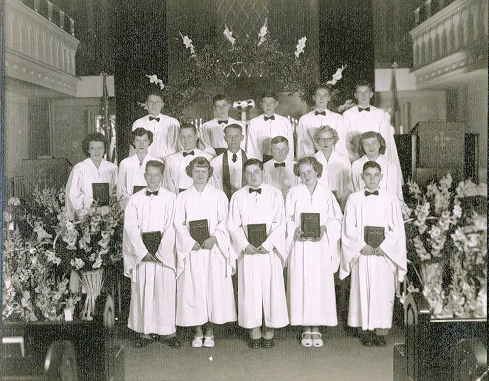 In this 1950 (8th grade) St. John Lutheran School confirmation photo, Vic Brelje is in the middle of the back row. Byron Grimes is at the far right of the first row.